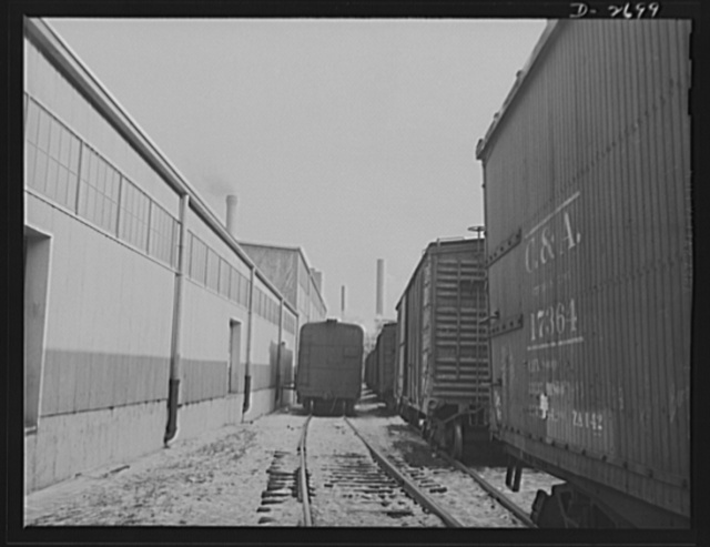 Fiberglass manufacture, Owens-Corning, Toledo, Ohio. At the loading dock in a Midwest warehouse, some seventy-five percent carloads of fiberglass materials are shipped daily to supply shipyards, electrical manufacturers, and other war industries