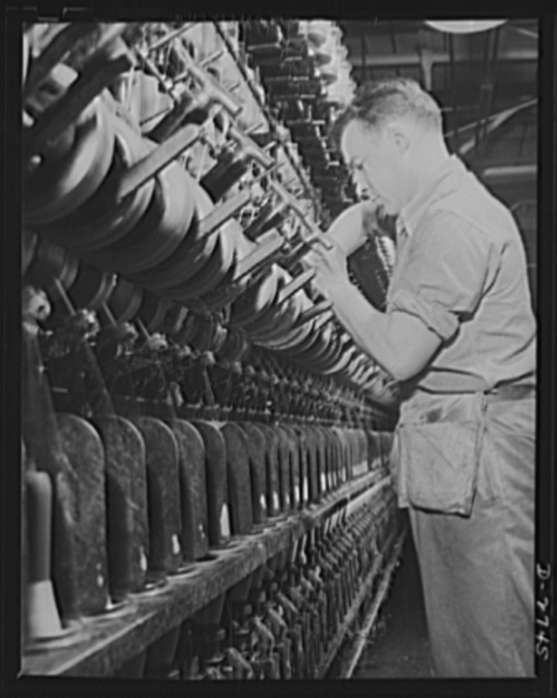 Fiberglass manufacture, Owens-Corning, Toledo, Ohio. Fiberglass yarns are twisted and plied on standard textile machinery as a step in the manufacture of tapes and cloths. These yarns are used principally to insulate electrical equipment operating under heavy loads