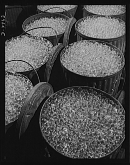 Fiberglass manufacture, Owens-Corning, Toledo, Ohio. Millions of carefully inspected glass marbles ready for remelting and forming into glass filaments. A single marble can be drawn into a continuous filament so fine that it could reach from New York to Philadelphia. More than one hundred filaments must be drawn together to make the finest workable strand