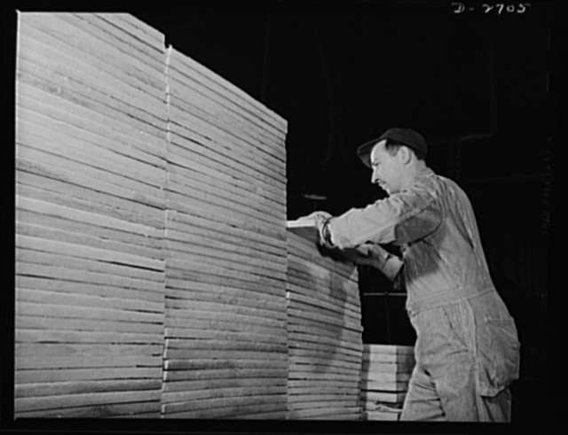 Fiberglass manufacture, Owens-Corning, Toledo, Ohio. Ready for cartons and bound for a shipyard are these neatly stacked boards of fiberglass insulation, surfaced with a fireproof all-glass cloth. The material is used to replace aluminum sheathing for interior finish in naval vessels. Installation methods developed by naval architects have resulted in rapid construction