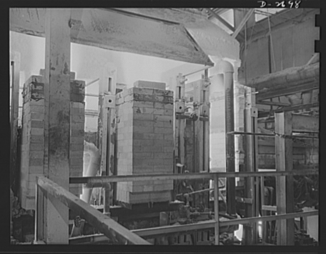 Fiberglass manufacture, Owens-Corning, Toledo, Ohio. Side view of a glass furnace melting the carefully compounded batch required for the production of fiberglass thermal insulation being installed in the hulls of naval vessels now under construction