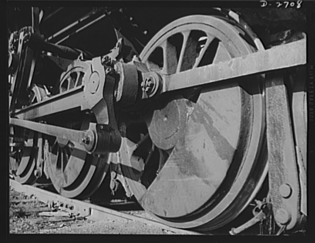 Fiberglass manufacture, Owens-Corning, Toledo, Ohio. The wheels of a switch engine are ready to shunt cars loaded with fiberglass materials onto the main line for movement to vital war industries