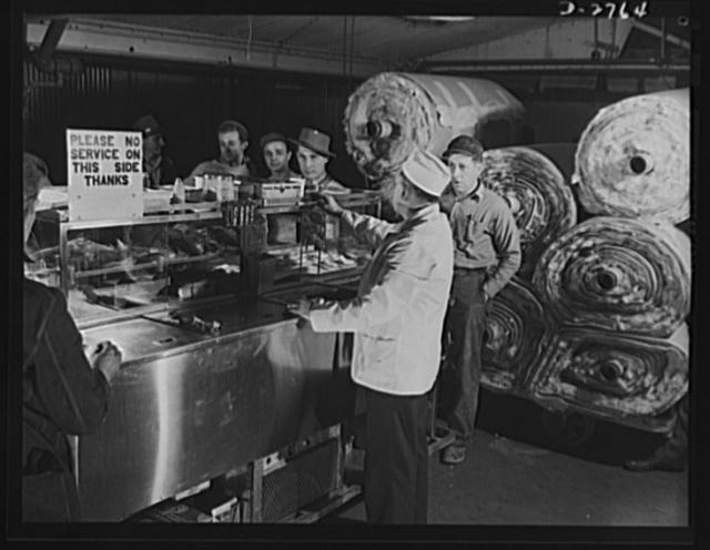 Fiberglass manufacture, Owens-Corning, Toledo, Ohio. Traveling lunch wagon provides food for men on the job in a plant of Owens-Corning Fiberglass Corporation