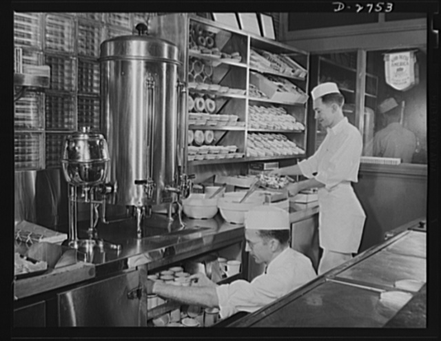 Fiberglass manufacture, Owens-Corning, Toledo, Ohio. Wholesome food is welcomed by workers in a plant of the Owens-Corning Fiberglass Corporation
