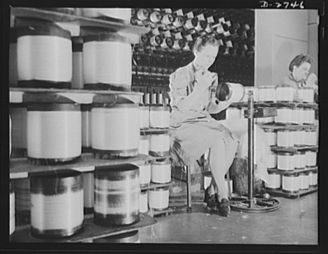Fiberglass manufacture, Owens-Corning, Toledo, Ohio. Workers in a plant of the Owens-Corning Fiberglass Corporation prepare strands of glass fiber for twisting into all-glass yarns