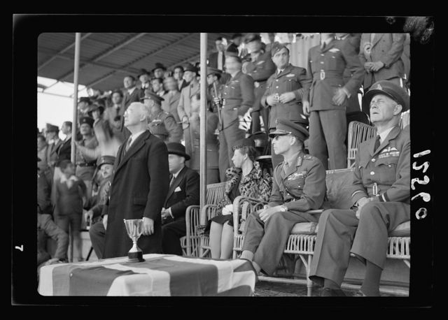 Football match on 'Y' field on Ap. 4, 1942 between Greek Air Force & 'Y' teams. King George of Greece present. About to present the cup (The King)