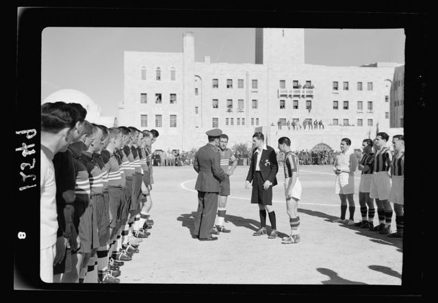 Football match on 'Y' field on Ap. 4, 1942 between Greek Air Force & 'Y' teams. King George of Greece present. The two teams arriving on the field
