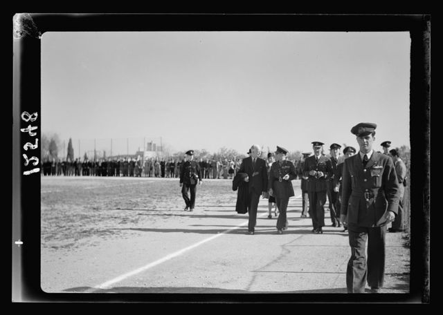 Football match on 'Y' field on Ap. 4, 1942 between Greek Air Force & 'Y' teams. King George of Greece present. H.M. King George of Greece arriving on the field, speaking with Mr. Miller