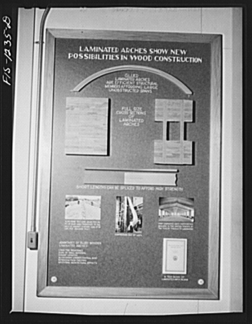 Forest Products Laboratory, Madison, Wisconsin. Exhibit panel on glued laminated wooden arches for use in buildings. This use of wood has been developed to a high degree at the laboratory. Its own box laboratory building is made with the use of these arches