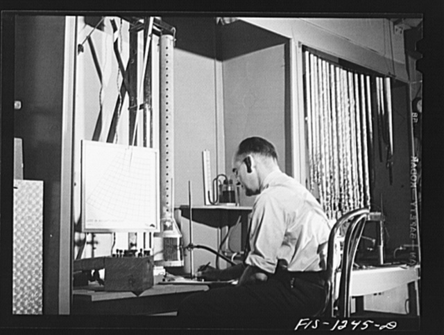 Forest Products Laboratory, Madison, Wisconsin. Testing the fire-resistant qualities of various types of wood impregnations and coatings by the use of the firetube. Mr. Arthur Van Kleek, in charge of the work, is taking the readings