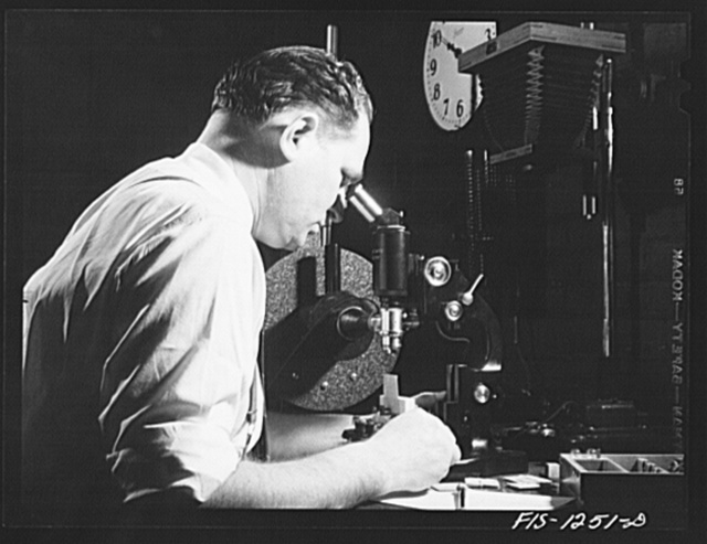 Forest Products Laboratory, Madison, Wissonsin. Dr. R.O. Marts in his laboratory. He is using an Ultropak microscope for the detection of obscure defects in airplane veneer