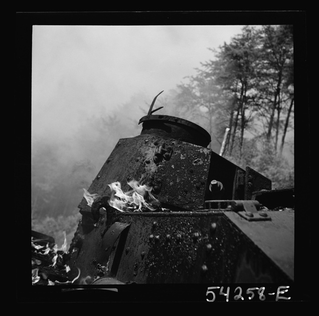 "Fort Belvoir, Virginia. A burning armored tank, showing the effects of a hit by a ""Molotov cocktail"" grenade"