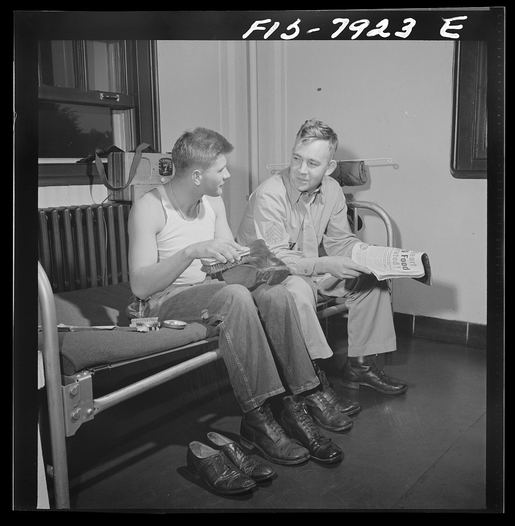 Fort Belvoir, Virginia. A regular part of Sergeant George Camblair's chores is shoe shining