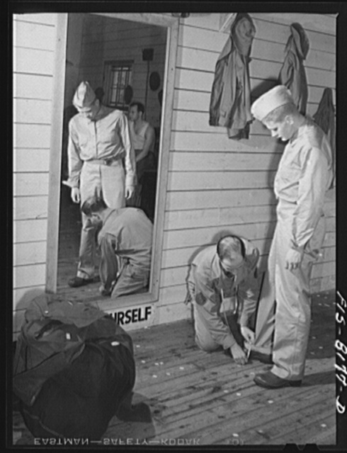 Fort Belvoir, Virginia. A tailor making any alterations that are necessary in George Camblair's uniform