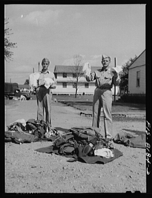 Fort Belvoir, Virginia. All the clothing George Camblair has received being carefully checked