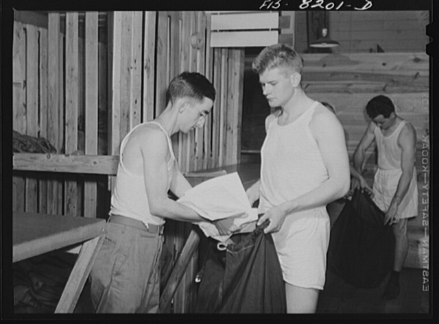 Fort Belvoir, Virginia. At the clothing warehouse George Camblair started with nothing and comes out completely equipped with clothing