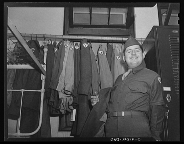 Fort Belvoir, Virginia. Constantine P. Lihas, a twenty-one year old Greek-American soldier, formerly a material handler at the General Electric Company plant at Pittsburgh. Both parents were born in Greece; father came to the United States in 1906, mother in 1921. He was born in this country and has been in the army five months. Lihas in his barracks