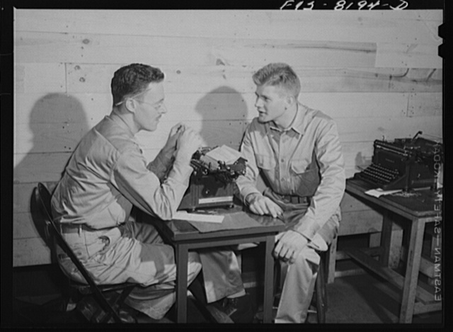 Fort Belvoir, Virginia. George Camblair discussing insurance problems with an officer at the reception center