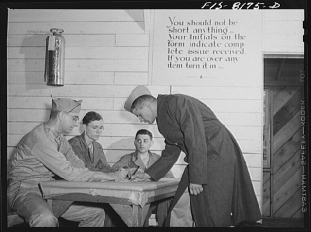 Fort Belvoir, Virginia. George Camblair signing for all the clothes he has received