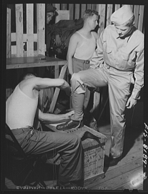 Fort Belvoir, Virginia. Issuing leggings to George Camblair at the clothing warehouse