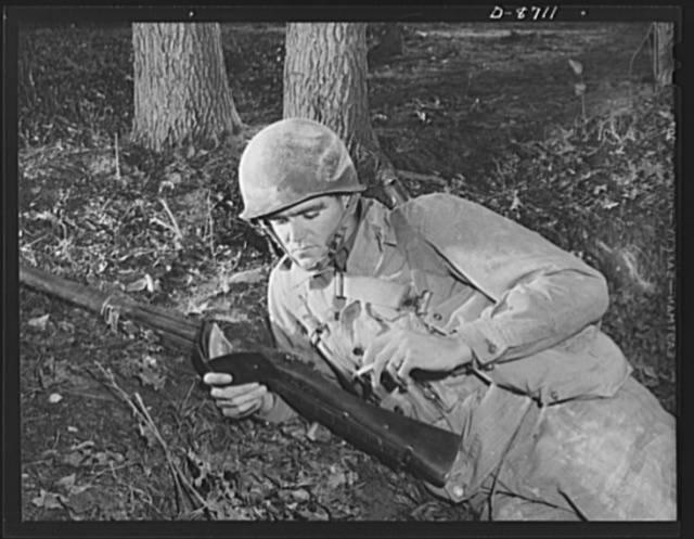 Fort Belvoir, Virginia. Negro grenade throwers. A soldier and his memories. An infantryman in training at Fort Belvoir, Virginia, looks over his cherished collection of pictures from home as he enjoys a cigarette during a well-earned rest period