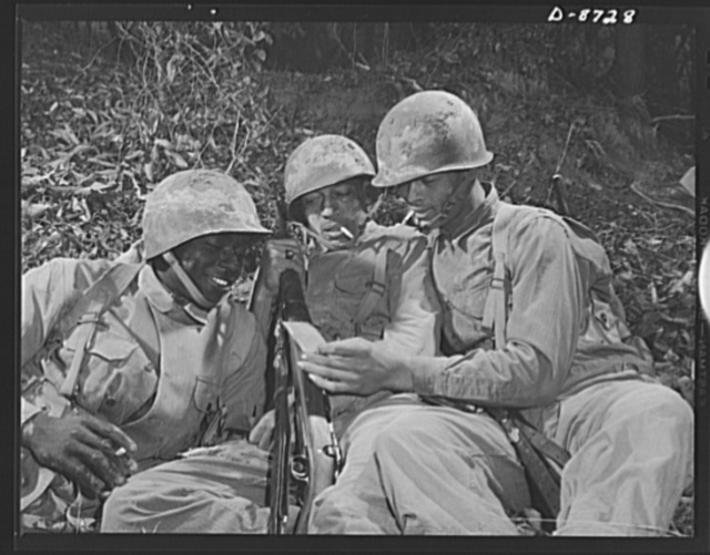 Fort Belvoir, Virginia. Negro infantry. These Negro infantrymen, enjoying a well-earned rest period during training exercises at Fort Belvoir, Virginia, represent a good type of soldier. When the Engineer Corps regiment to which they belong is graduated from Fort Belvoir they will be well prepared for military duty