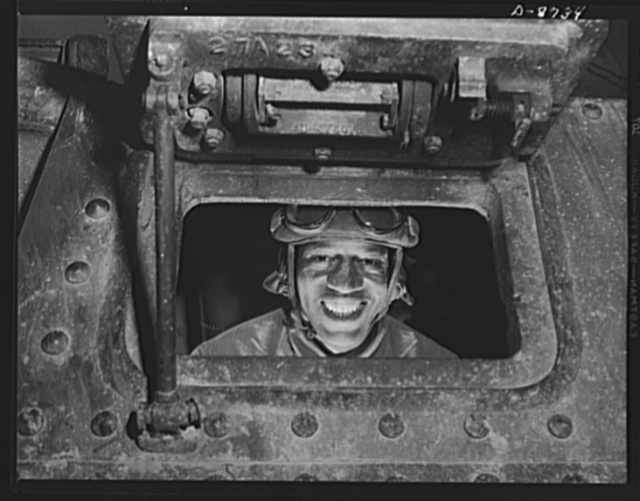 Fort Belvoir, Virginia. Negro tank crews. Member of an all-Negro tank crew in training at Fort Belvoir, Virginia. The hard, steady routine of war exercises at this post is changing men with little or no previous experience into competent tank crew members, infantrymen and specialists in the manifold tasks of the Engineer Corps