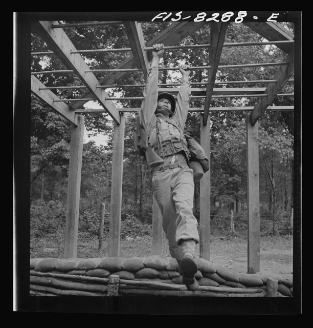 Fort Belvoir, Virginia. Sergeant George Camblair getting a rigorous physical training on the obstacle course