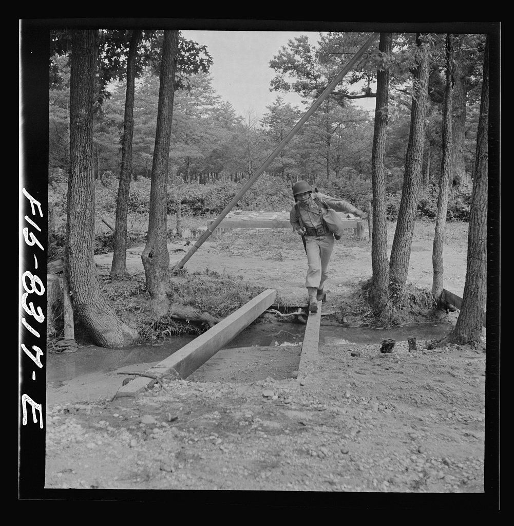 Fort Belvoir, Virginia. Sergeant George Camblair getting rigorous physical training on the obstacle course