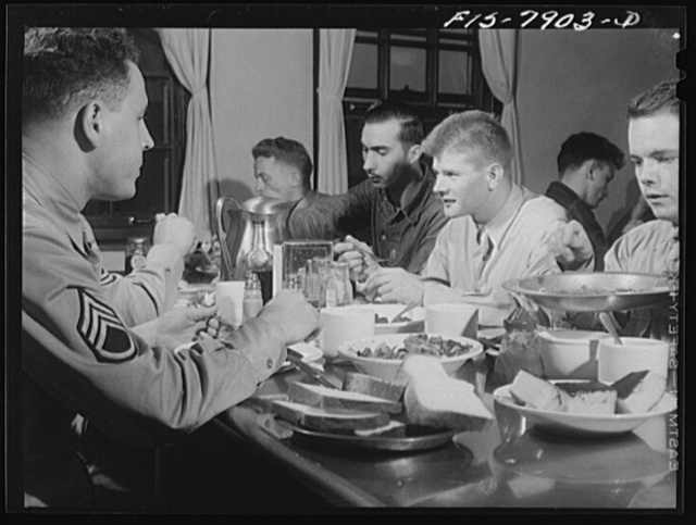 Fort Belvoir, Virginia. Sergeant George Camblair in the mess hall for lunch