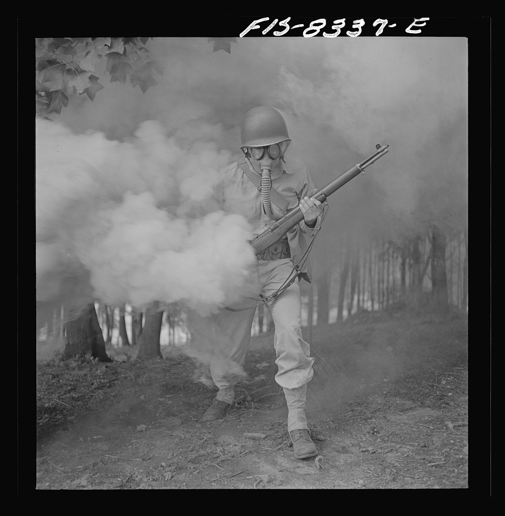 Fort Belvoir, Virginia. Sergeant George Camblair learning how to use a gas mask in a practice smokescreen