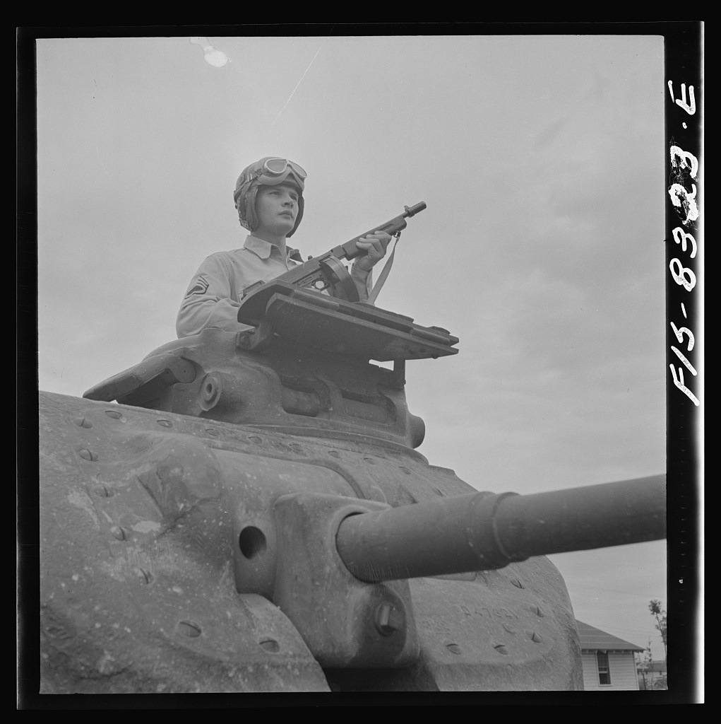 Fort Belvoir, Virginia. Sergeant George Camblair learning the operation of a tank