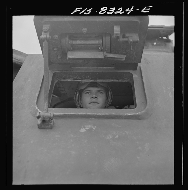 Fort Belvoir, Virginia. Sergeant George Camblair learning to drive a tank