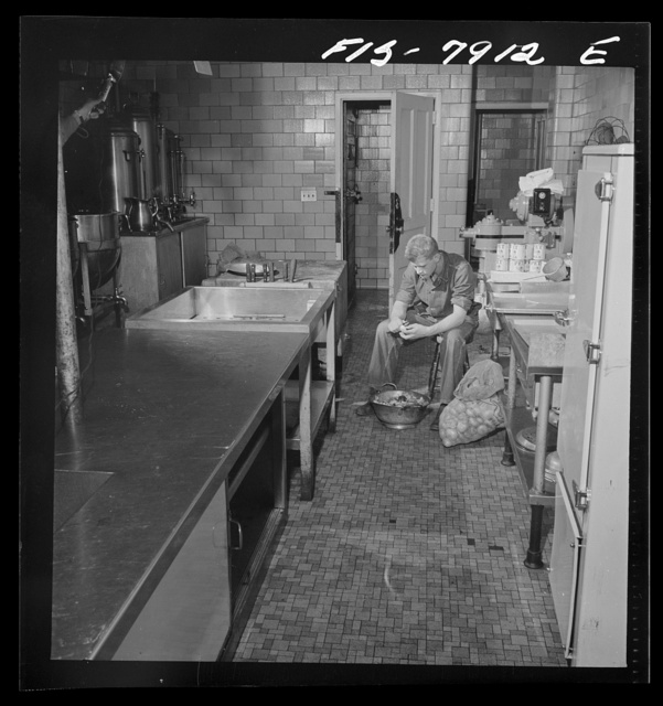 Fort Belvoir, Virginia. Sergeant George Camblair on kitchen police duty