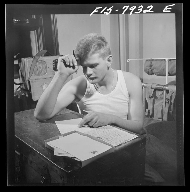 Fort Belvoir, Virginia. Sergeant George Camblair writing letters home from camp