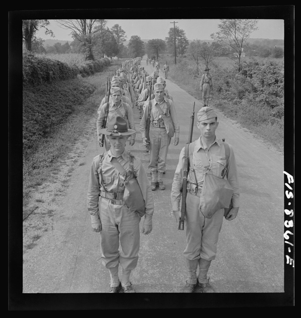 Fort Belvoir, Virginia (vicinity). Sergeant George Camblair on a march along the road near camp