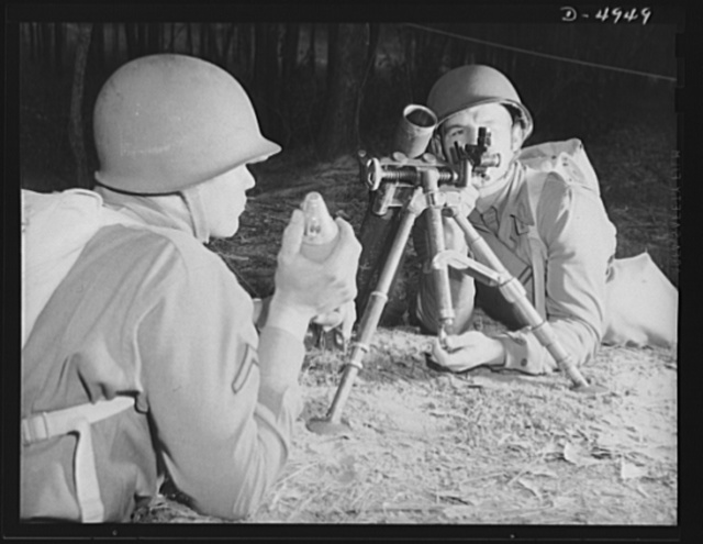 Fort Benning. 60 mm. mortars.  A couple of experts at slowing up the Axis timetable. These two members of a machine gun crew doing post-graduate work at Fort Benning, Georgia with a 60 mm. mortar. It's a piece that can do a lot of damage, and they know how to use it