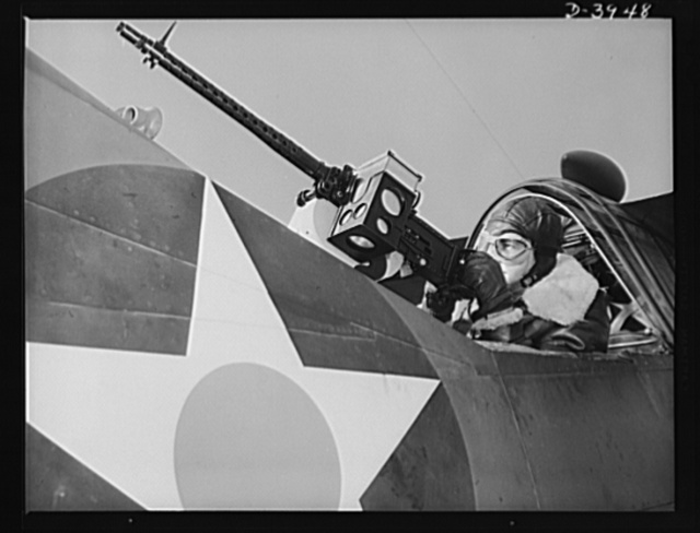 Fort Benning. Aerial machine gunners. Four aces. This crack aerial machine gunner is a part of an unbeatable combination. He has a fast, accurate gun and the world's best in the way of plane and pilot