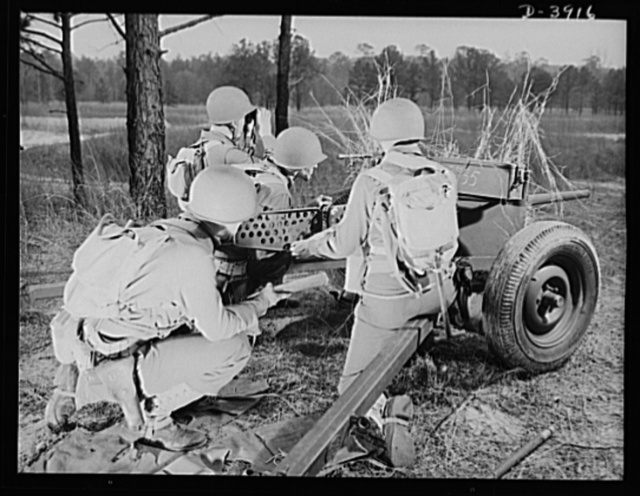 Fort Benning. Anti-tank gun crews. Bad news for Axis tanks. The crew of a 57mm anti-tank gun, one of many in training at Fort Benning, Georgia already handle their piece with the snap and precision of an old timer