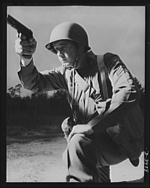 Fort Benning. Anti-tank gun crews. He's good with any kind of gun. This infantryman, finishing training at Fort Benning, Georgia, belongs to the crew of a 37mm anti-tank gun