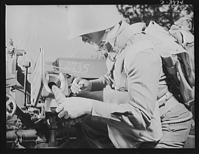 Fort Benning. Anti-tank gun crews. The infantryman, loading a 37mm anti-tank gun, trains at Fort Benning, Georgia to do many useful military chores with the this hard-hitting piece