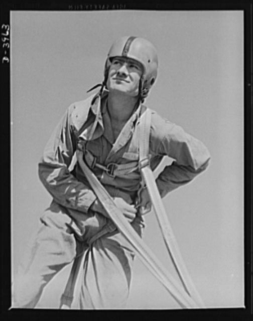 Fort Benning. Parachute troops. He's a landsman again. One of Uncle Sam's student paratroopers at Fort Benning, Georgia unbuckles his chute gear after a trip that would have done credit to one of the oldtimers