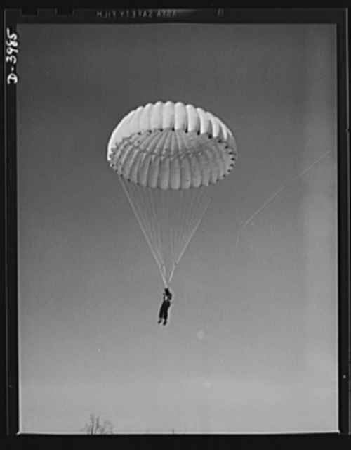 Fort Benning. Parachute troops. Look at that boy come, riding a chute like an oldtimer. A student paratrooper at Fort Benning, Georgia has wind currents to think about, and he has his mind on the spot where he wnats to land. He's learning to make the kind of a landfall he wants