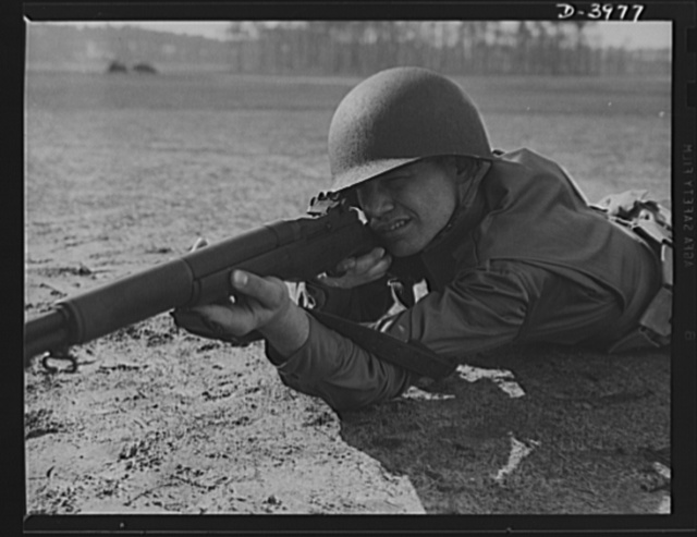 Fort Benning. Rifleman. Garand rifle. When Uncle Sam makes big medicine against his enemies, he puts in strong ingredients. An American infantryman with a Garand rifle to meet the Army's high standards of workmanship