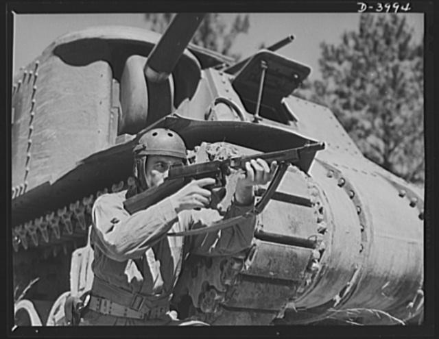 Fort Benning. Tommy gunners, armored forces. The tank soldier finds many chores for the Thompson sub-machine gun, familiarly known as the Tommy gun