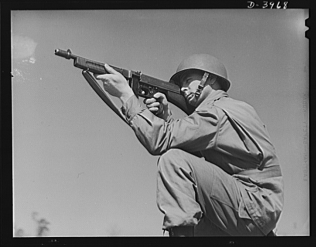 Fort Benning. Tommy gunners, parachute troops. An American paratrooper and his Tommy gun go into action as soon as they reach the ground