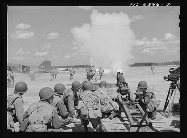 Fort Bragg, North Carolina. Airborne artillery cooperating with parachutists to take over an airfield in a military demonstration