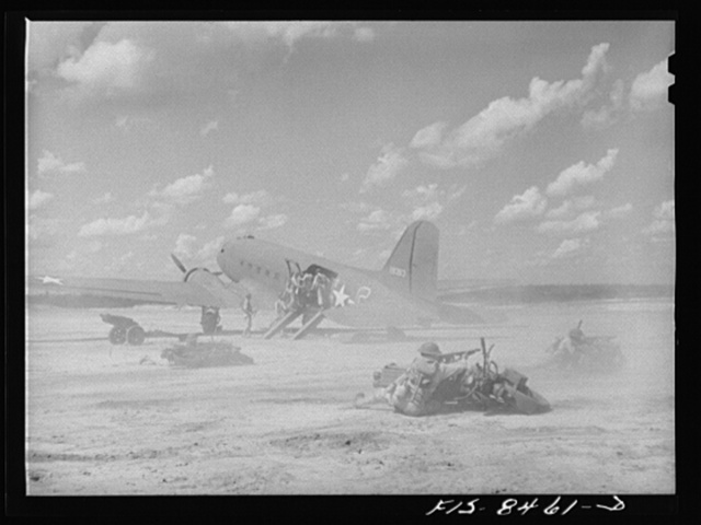 Fort Bragg, North Carolina. Airborne motorcyclists and artillery taking over an airfield in a military demonstration