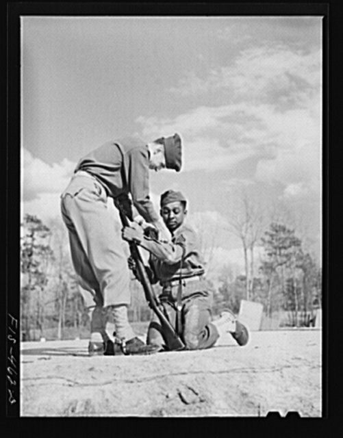Fort Bragg, North Carolina. Officer showing Sergeant Williams how to shoot