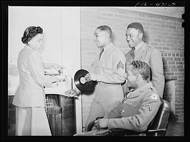 Fort Bragg, North Carolina. Sergeant Williams with the USO (United Service Organization) hostess in a service club
